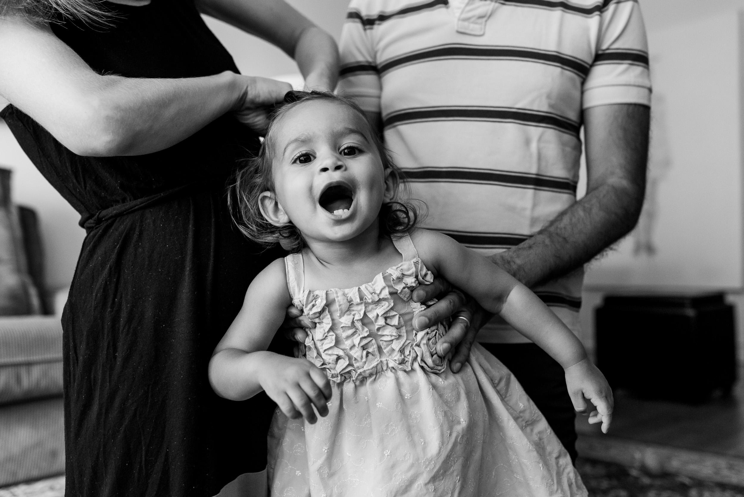Deborah-Barak-Documentary-Family-Photography-Brooklyn_toddler-getting-hair-done.jpg