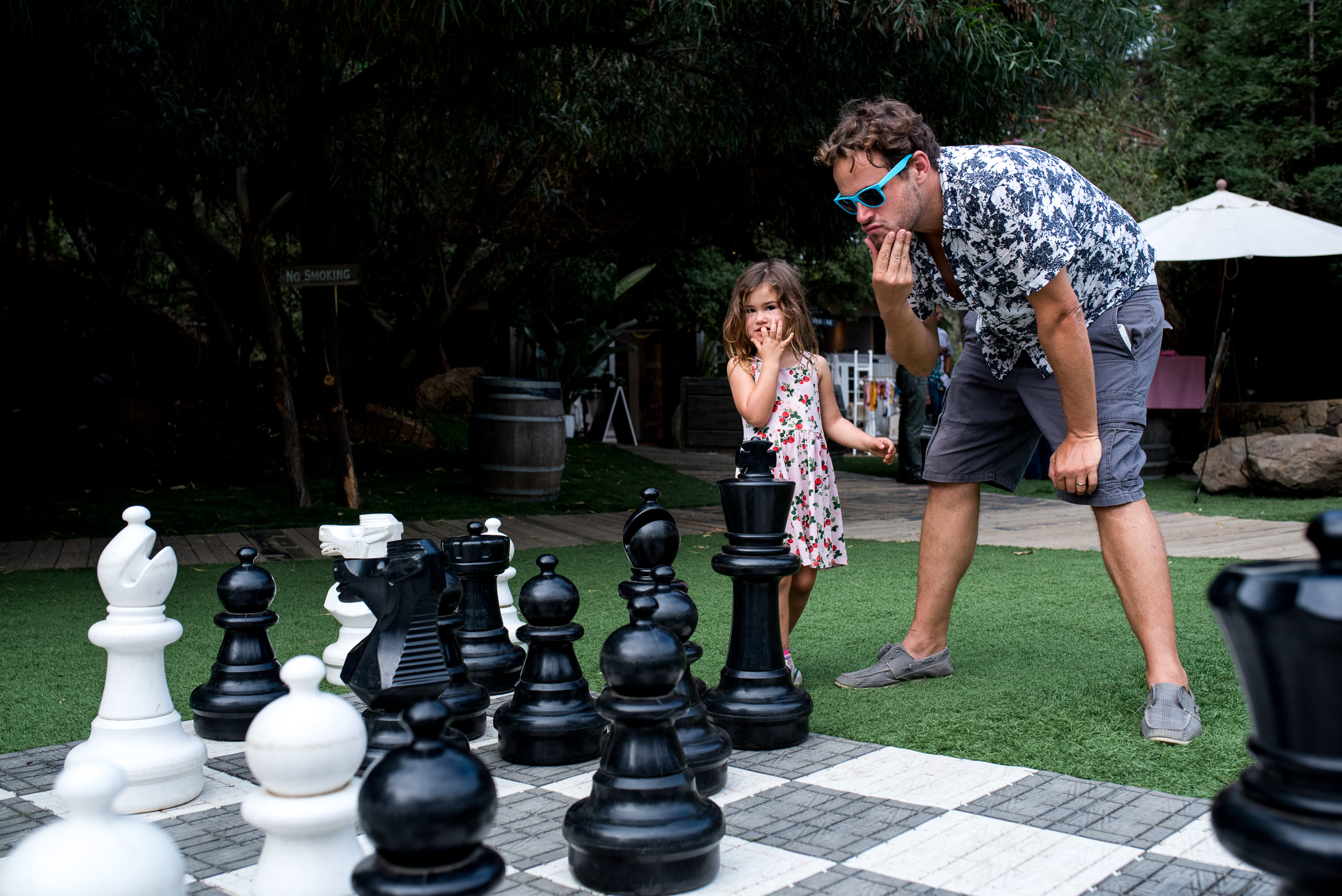 Deborah-Barak-Documentary-Family-Photography-Brooklyn_NYC_girl-and-dad-play-chess.jpg
