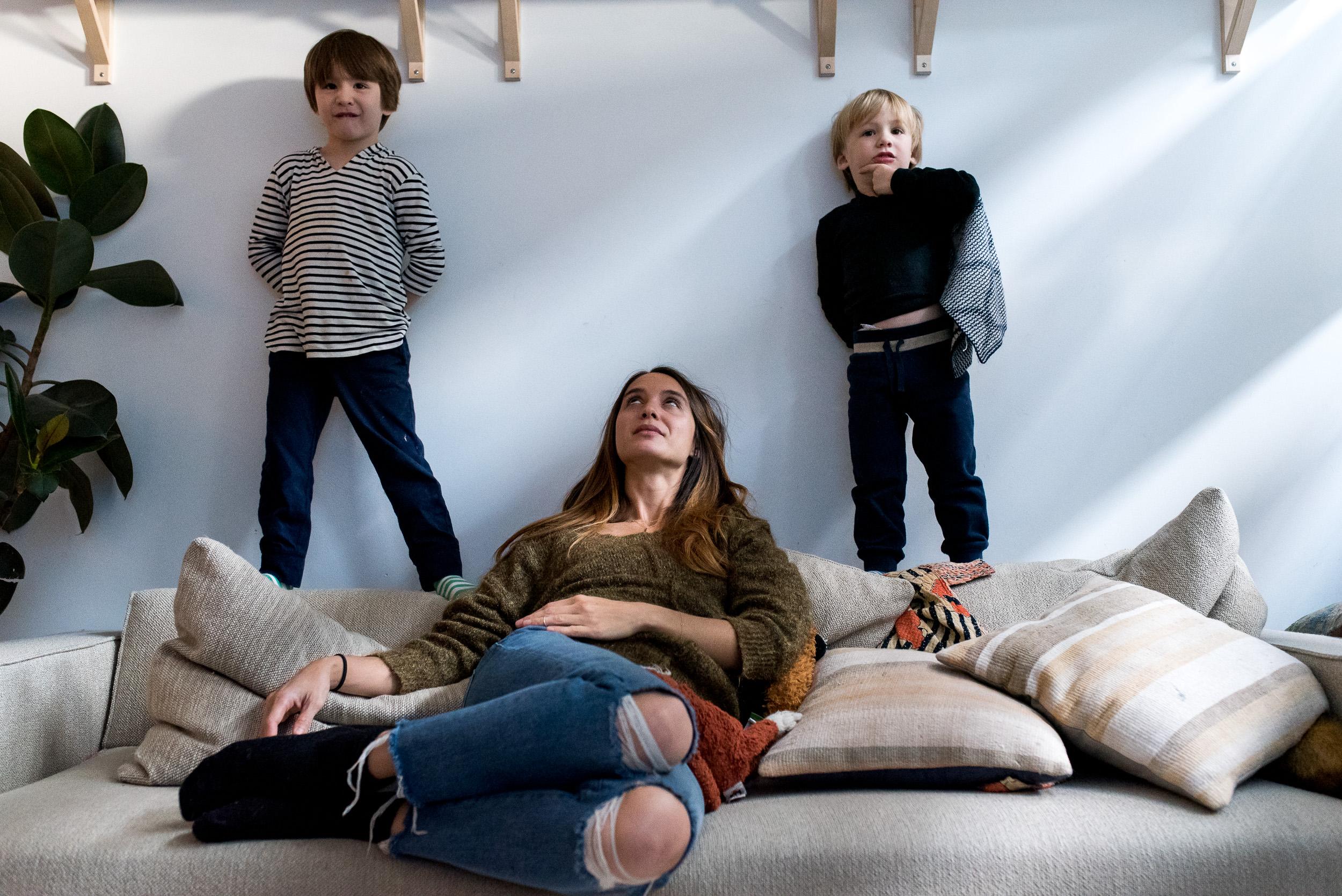 Deborah-Barak-Documentary-Family-Photography-Brooklyn_NYC_two-boys-and-mom-on-the-couch.jpg