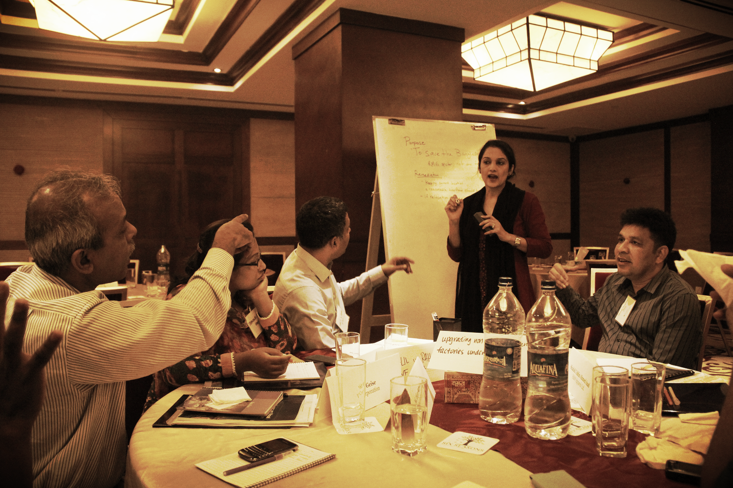Sourcing agents, company representatives, and civil society organizations debate the future of the garment industry, Dhaka, May 2014.