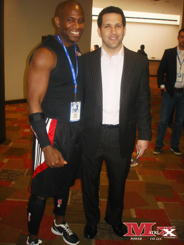 Calvin w Sport Comentator Adam Schefter @ NFL Comine 2011