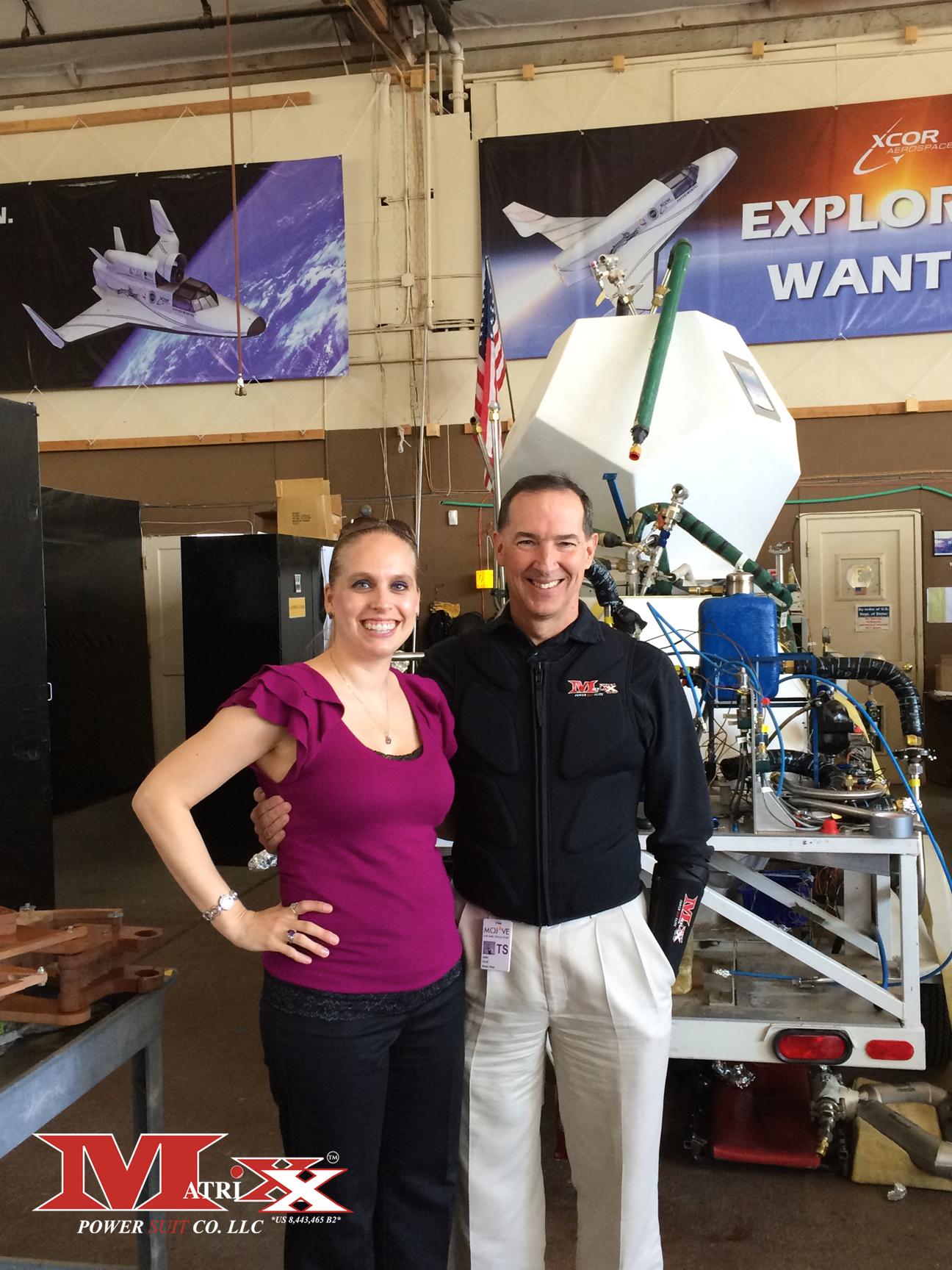 Holly w test pilot Brian Binnie @ XCOR Aerospace 10-11-2014