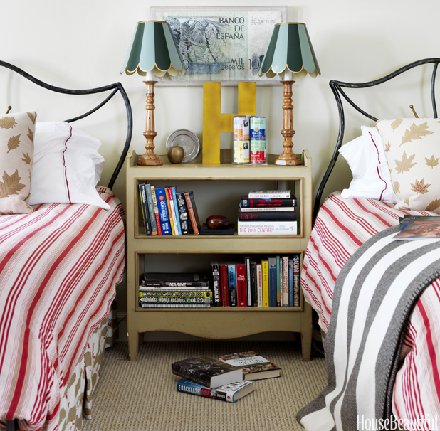 We love the mixture of pattern in this bedroom seen in House Beautiful !