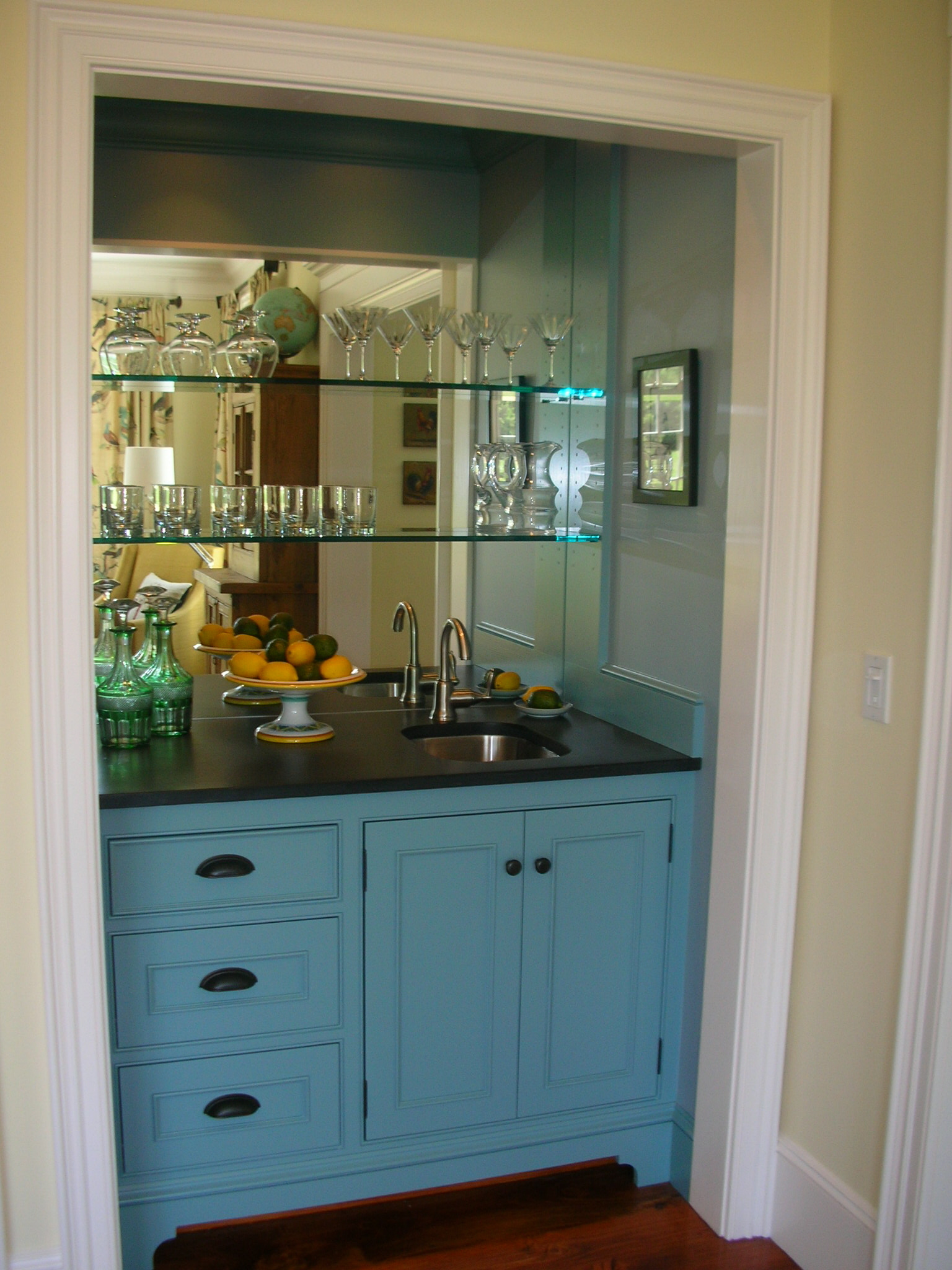 This built in wet bar has lots of storage.  Another plus is the mirrored back wall.  It helps reflect light in the space.