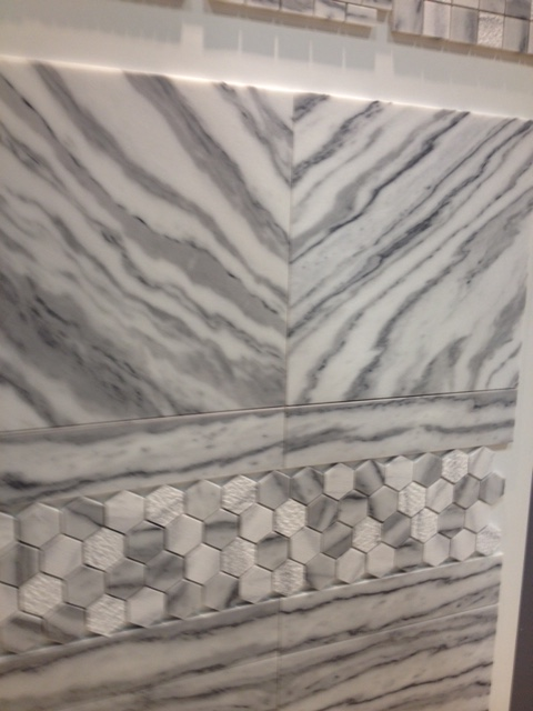 I love how the top tiles are laid in a way to create a chevron pattern. A little of this goes a long way.