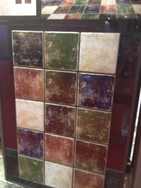 These ceramic tiles have a great patina. They would be beautiful to create a checker board floor out of 2 of the colors.
