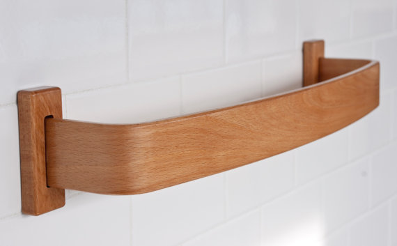 This beautiful  Beech Bentwood towel bar can be found on Etsy.  Other species available, too.