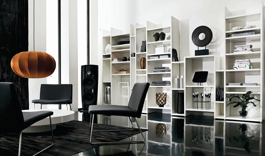 This room is simple, believe it or not! Simple white shelves are the perfect backdrop to objects of art. The black glossy floor reflects the shelves and art.