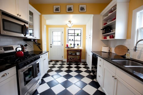 On a budget? Stock black and white ceramic tiles give a lot of bang for the buck!