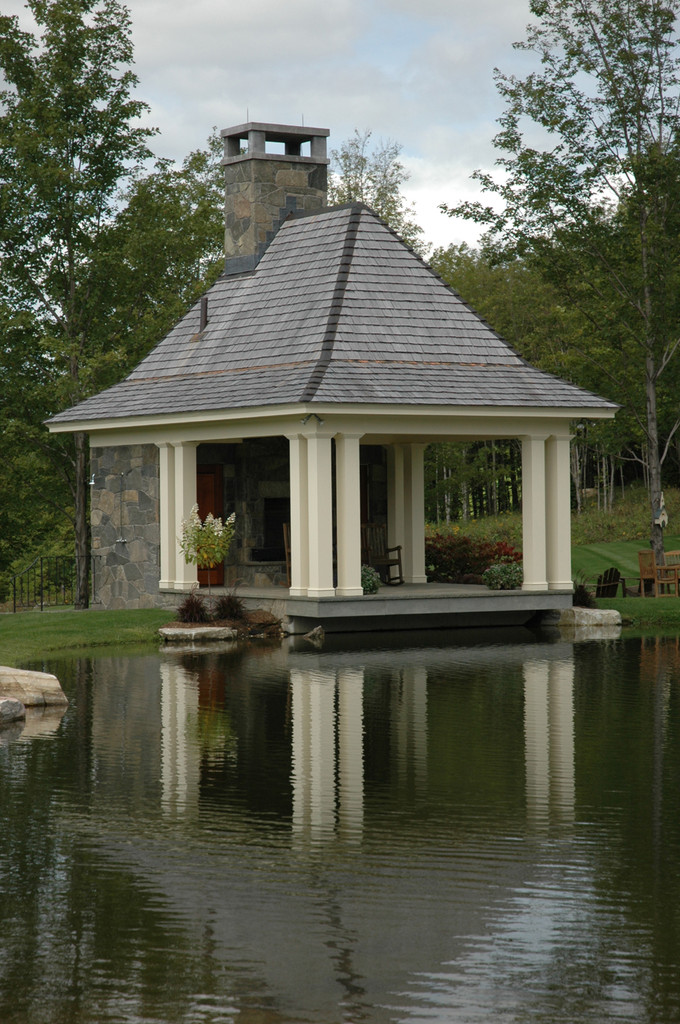This stone pavilion designed by  Ramsay Gourd Architects  cantilevers  over the pond.  In the winter when the pond is frozen you can skate up to it and take off your skates to sit by the fire!  It also houses a kitchen and changing room.