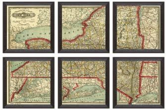 I love this idea of taking an over sized map and framing  it in series .  Looks like the map has been hand colored, too.