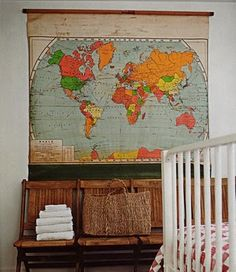 School room maps are great wall art.  If they still have their roller, they can also be used to camouflage a wall mounted TV.