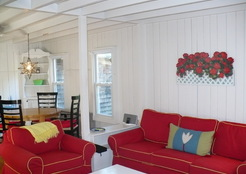 The walls, ceiling and trim in this 1860's cottage on Martha's Vineyard is painted white. It provides a nice backdrop to the bold furniture.