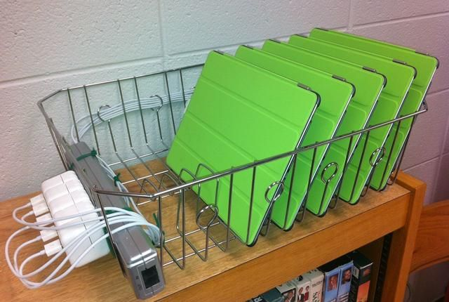 I am sure a teacher on a limited budget came up with this!  A drain rack power strip and zip ties!