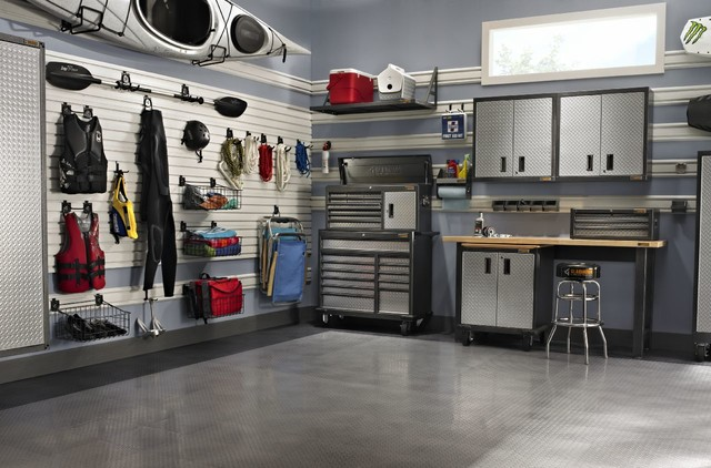 This watersport enthusiast has perfected a storage and workspace solution for this garage. How could you adjust your garage space to fit your passion projects!