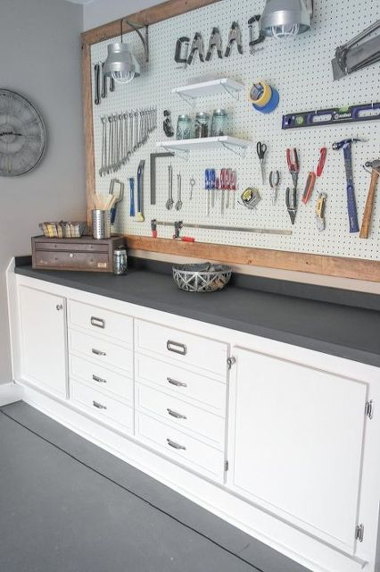 A clean and practical storage/workbench solution.If only my husband's workspace was this easy on the eyes!