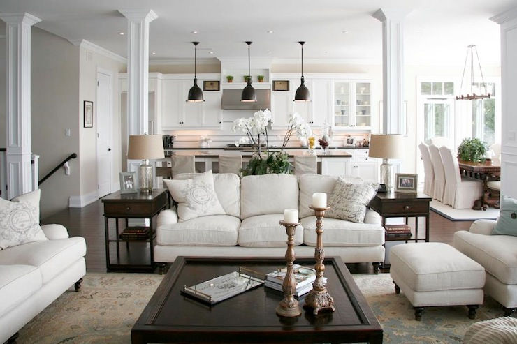 Here's a neutral zone I could spend my day in! Cooking, eating, lounging, this multipurpose space is both comfortable and stylish.
