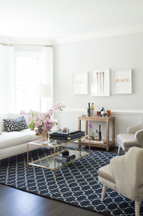 Bold in blue! This living space is transformed with a bold choice in just a rug and throw pillow. Not feeling blue? With a simple rug and pillow switch, the space can be completely reimagined.