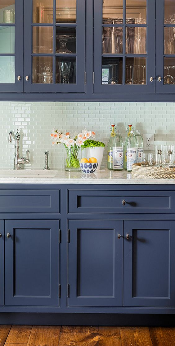 The hint of color in this colored glass backsplash is just enough to lift the space above it's routine, adding depth and visual interest to the space.