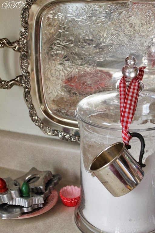 What a neat use of the everpresent silver baby cup! Used here as a scoop and measure.