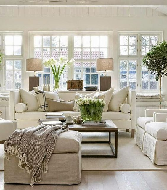 Even in neutrals, rugs can add comfort, warmth, and a relaxed elegance to a room.