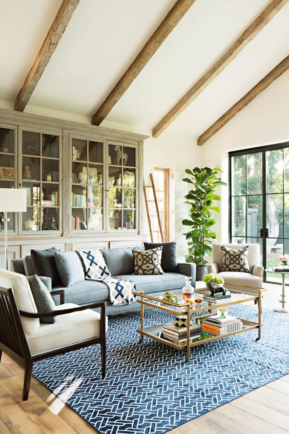 Neutral walls and furnishings allow a bold rug to take center stage. It is a nice way to add color to a room when you don't want to commit to strong color on the furnishings or window treatments.