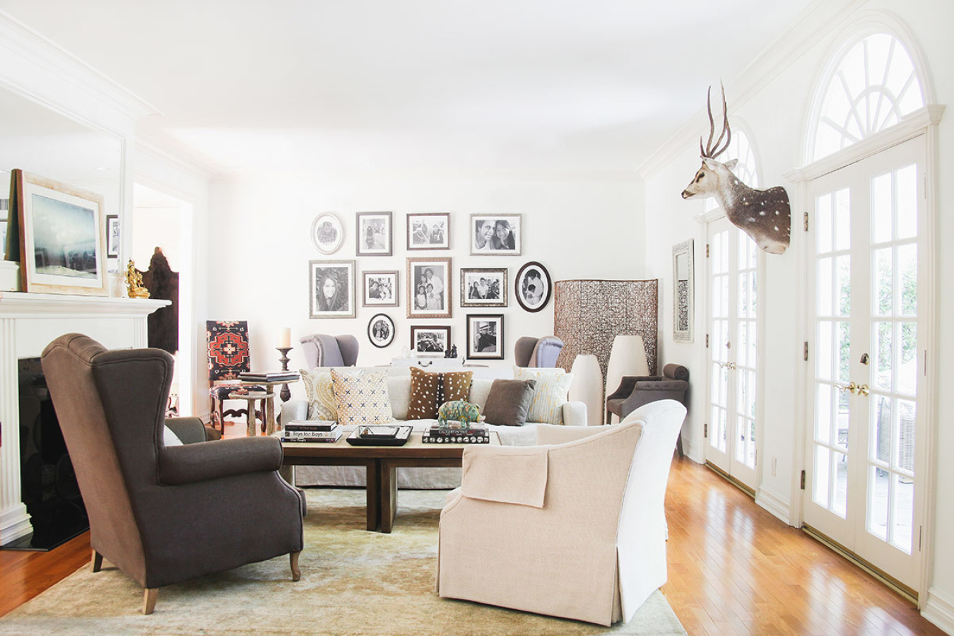 In this cozy room, family photos printed in black-and-white lends an authentic and personal touch that compliments the neutral color palette.