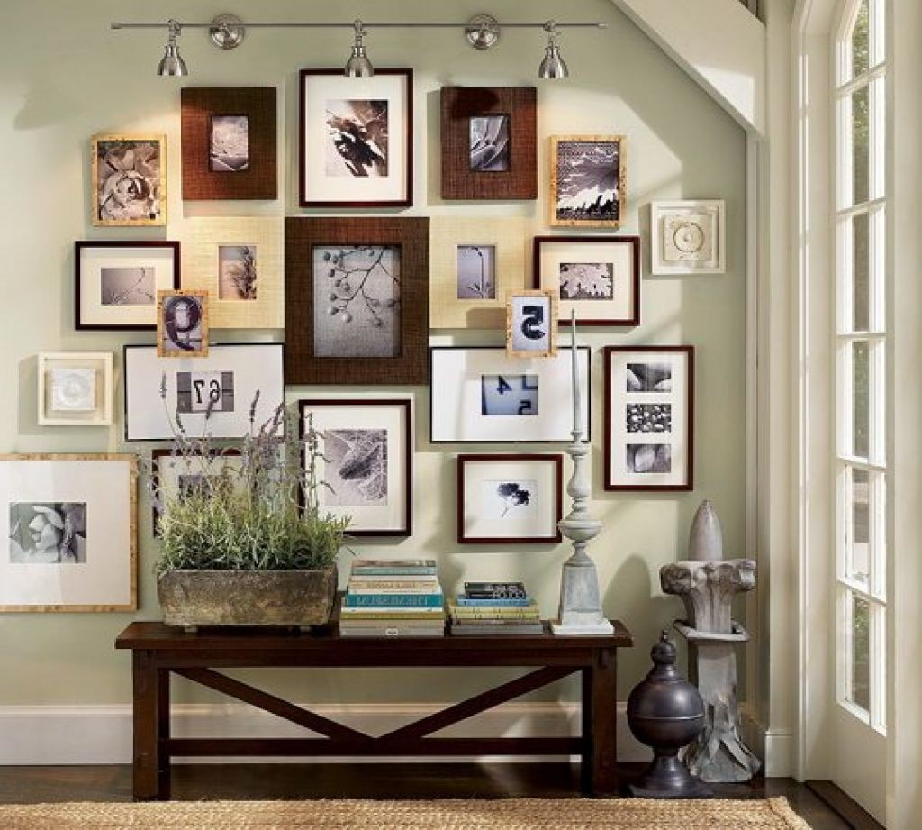 I love the variety of sizes and shapes used here, yet the wooden frames and pictures keep the cohesive.