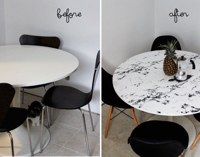 I saw this image on the Homedit website. This table top is actually covered with a marble look contact paper. That's a quick option, too!