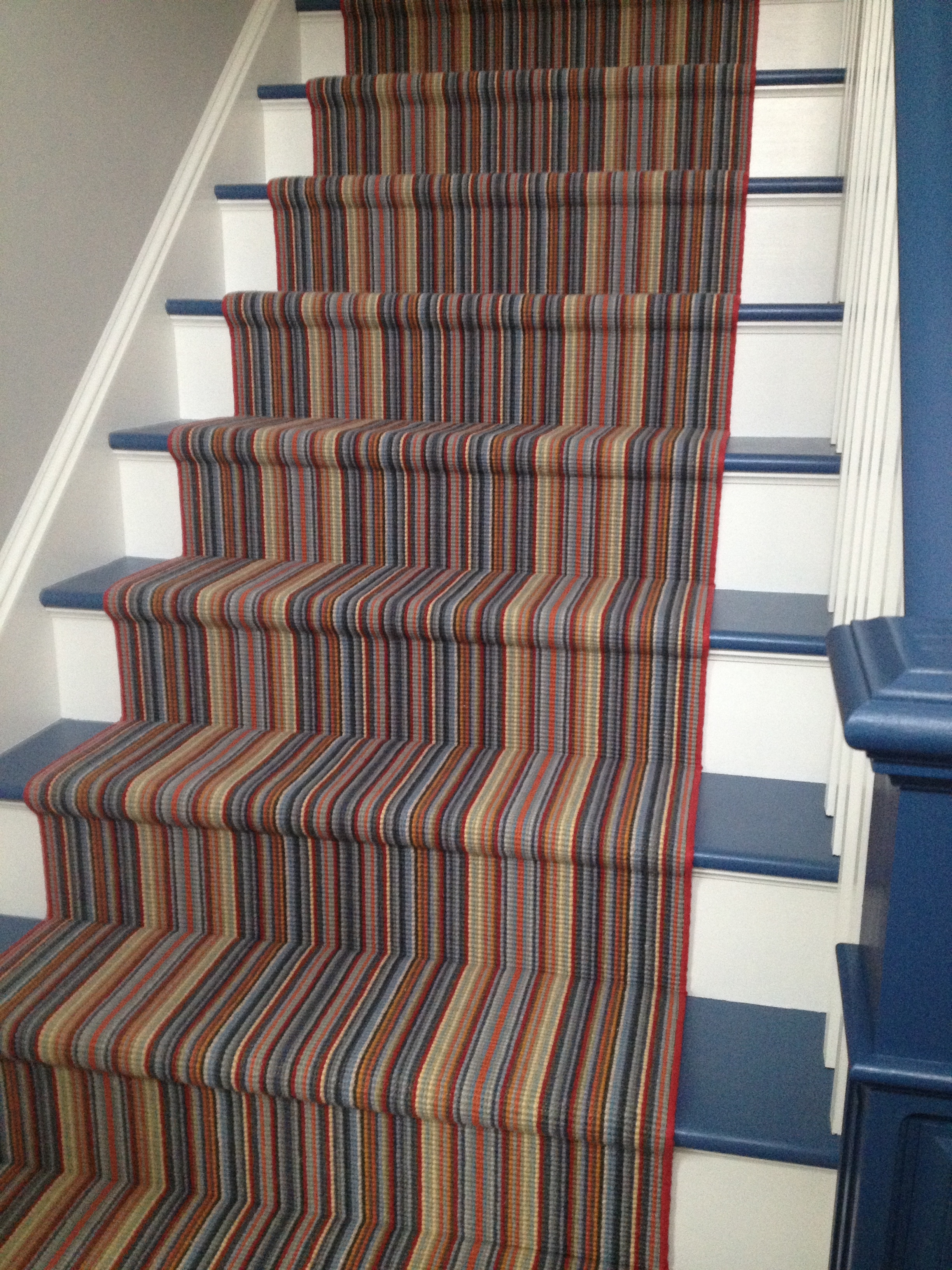Before the renovation of this house, these wood treads leading to a play room were a hazard for the 3 active boys that vacationed here. By painting the treads and adding this bound runner from  Weave Tuft we not only added stability but FUN STRIPES!