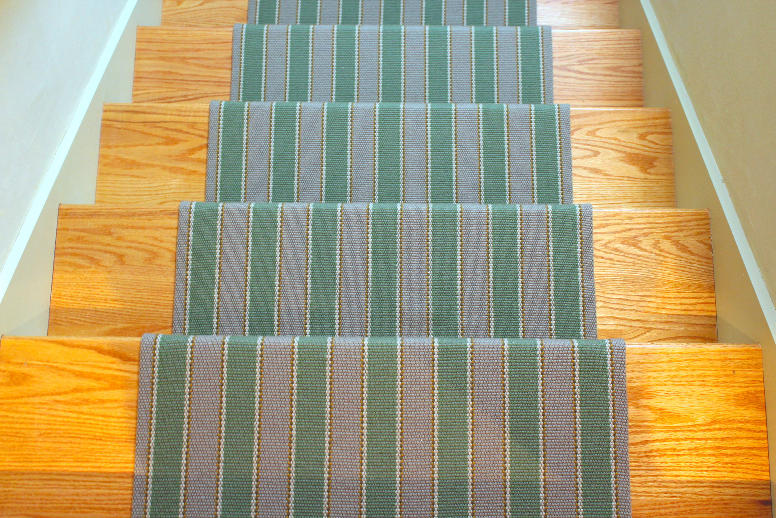 """The back stairs at this mountain home is jazzed up by this  Fleetwood Fox wool runner. We like to leave about 5""""-6"""" on either side of the runner to show off the tread."""