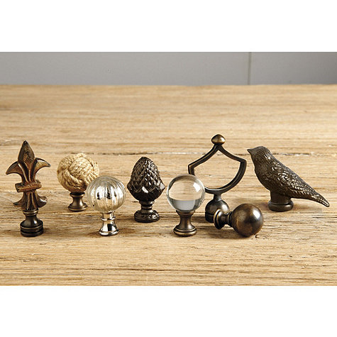 These are a few typical finials that are commonly used, also from  Ballard Design.