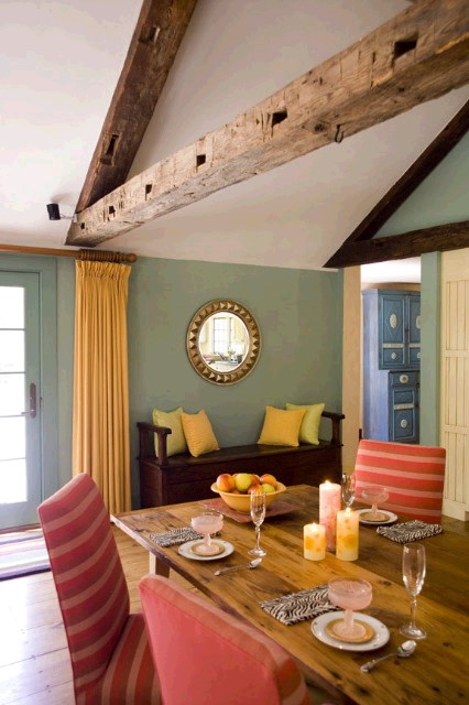 The old beams were added to this addition to make it appear like an old barn. Very effective!