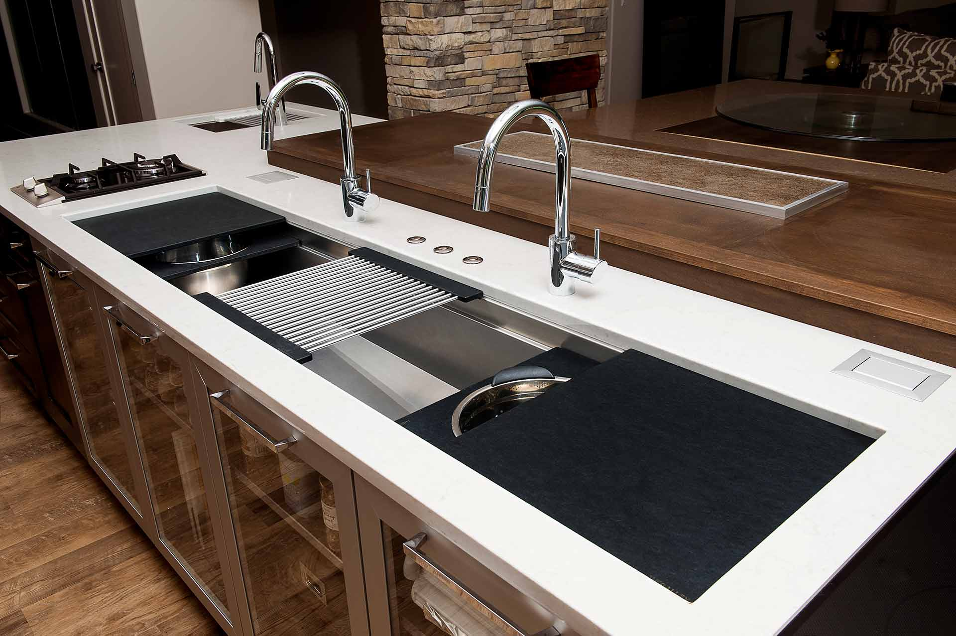 If a new sink is in your future, consider this workstation from The Galley. All stainless with cutting boards, drain racks and colanders that slide to make a perfectly functional and asthetically pleasign work area.