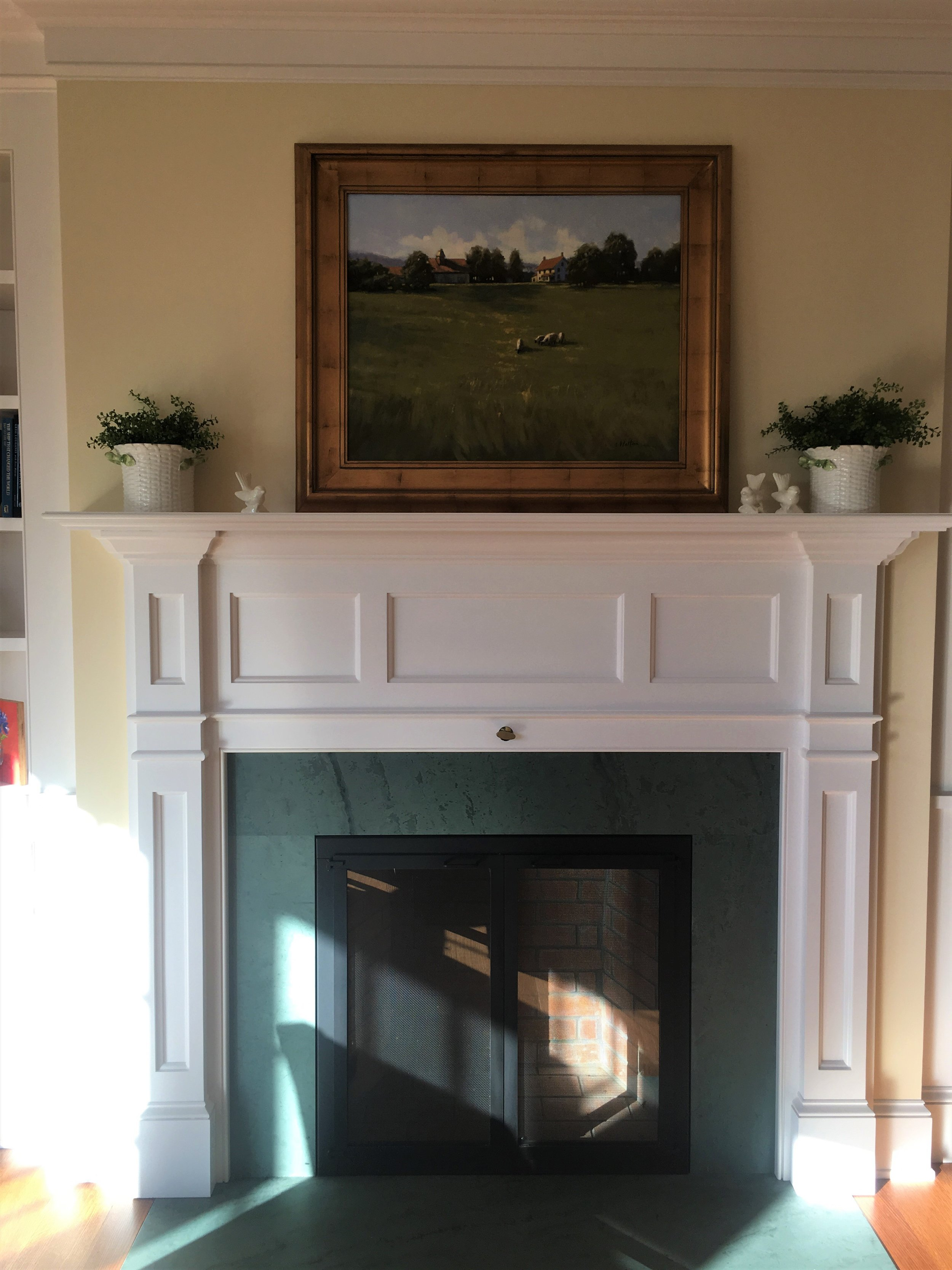 This fireplace is surrounded by Vermont green slate, indigenous to the area the house was built. Believe it or not, this is in a brand new home, but the mantle detail suggests it has been in existence for at least 100 years. Neutral walls and trim never go out of style.