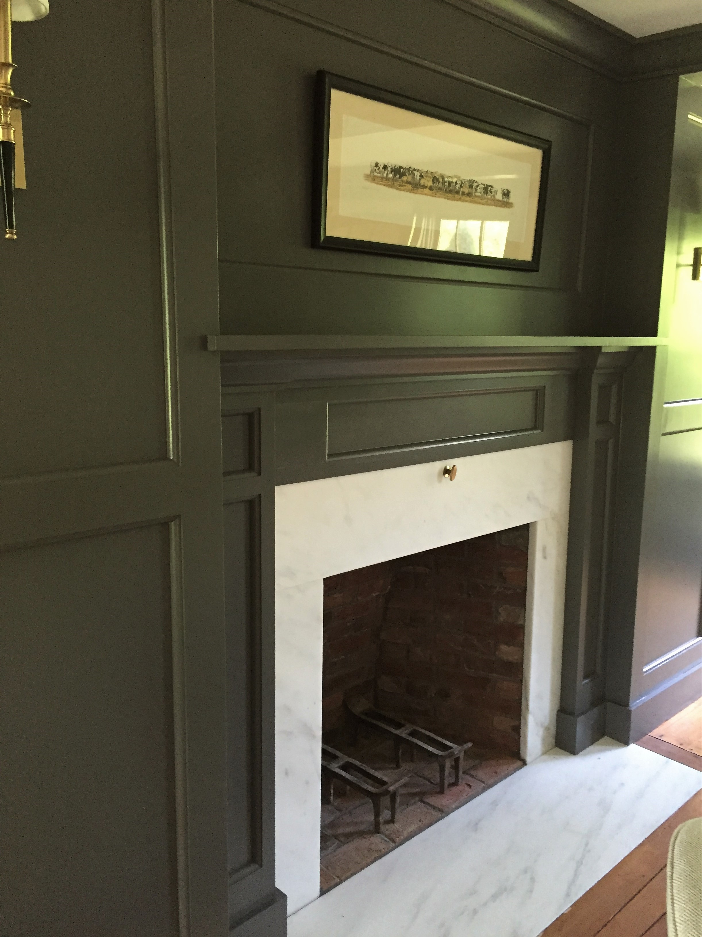 Another antique fireplace! If those bricks could speak! We did make some repairs and replaced the hearth and surround with Danby Marble, indigenous to this area of Vermont. Walls are painted  Benjamin Moore  Kendall Charcoal and add to the coziness of the room.