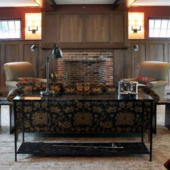 We were fortunate to work with a local craftsman, Dan Mosheim to design the black walnut paneling in this room. It creates a warm surround for the room and a nice backdrop for the brick fireplace. We continued the brick to the fireplace surround and hearth (sorry you can't see it) so we didn't detract from the beauty of the wood.