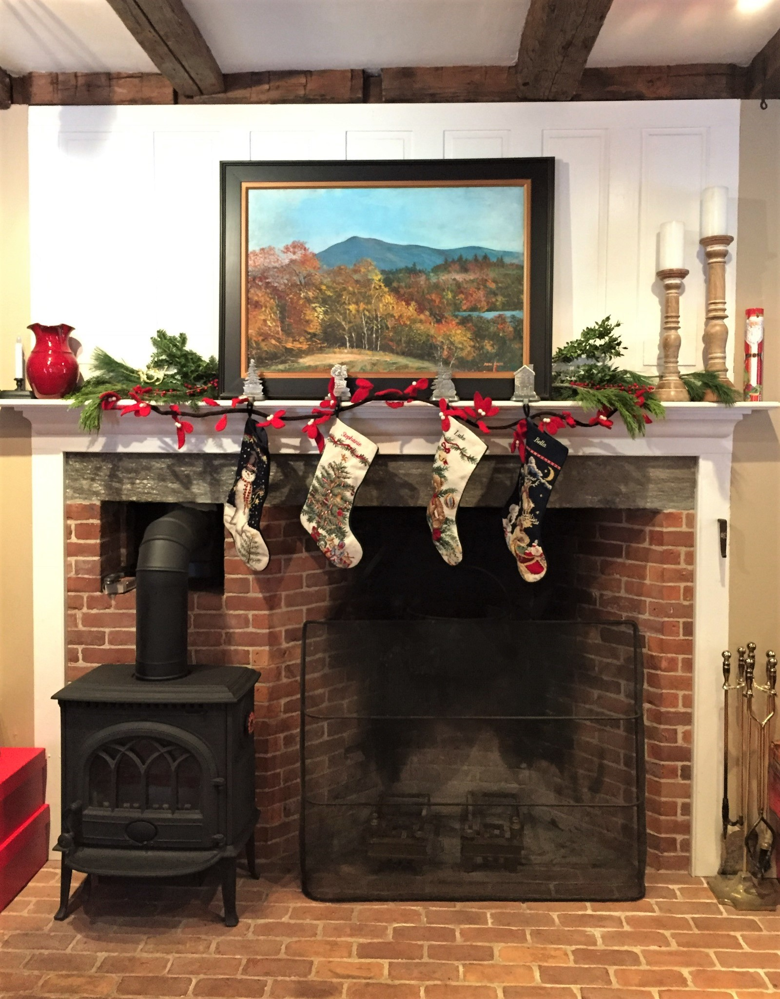 This was an interesting project. The original house was built in the 1820's with a center chimney with 3 fireplaces to heat the house. The house was dismantled in the 1980's and moved to its current location. The chimney could not be moved, but was recreated in the same manner. This is the main fireplace where cooking would have happened. There is an iron bracket that holds a large iron kettle for cooking food. There was a bread oven on the left side that the owners added a small wood stove to. The brick hearth and surround work nicely with the original beams and painted wood paneling.
