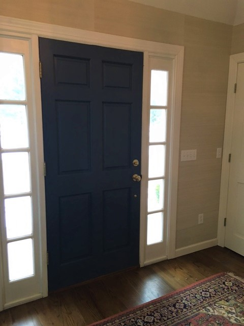 We picked Benjamin Moore's Bold Blue (a color found in the rug) for the inside of the door. It's a nice contrast to the grass cloth on the walls.