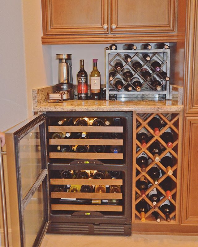 Custom wine rack and cellar. Midweek cheers! 🍷 . . . #kitchencabinets #customcabinetry #winedownwednesday #winecellar #winerack #kitchengoals