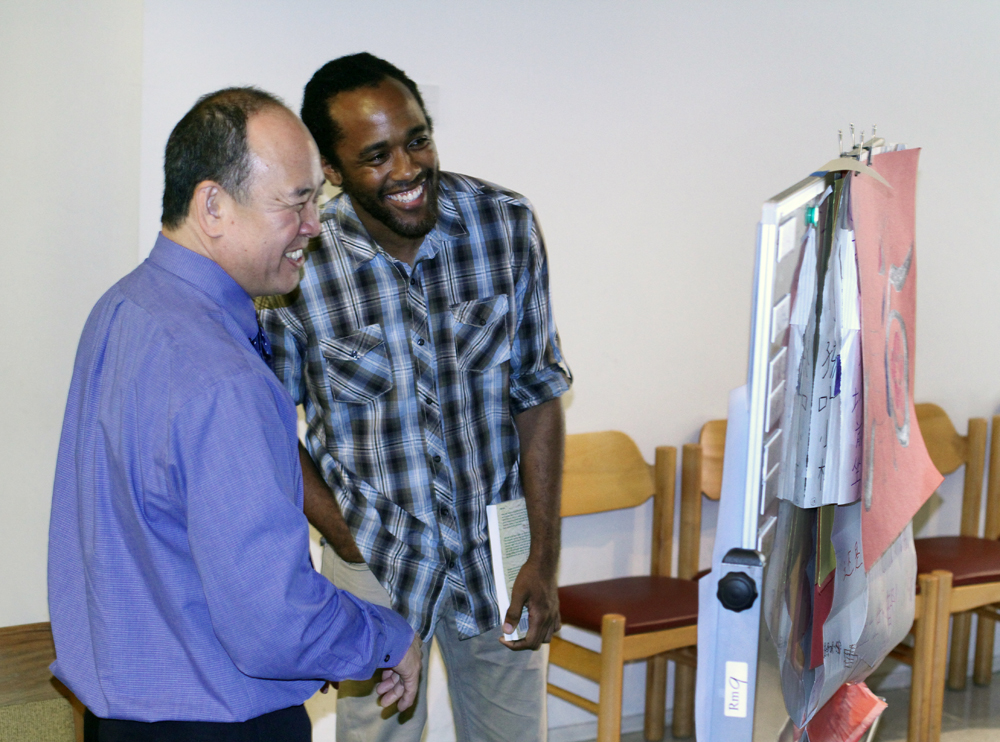 Creative expression co-director Sekayi edwards (on right) with aldersgate pastor, roger morimoto.