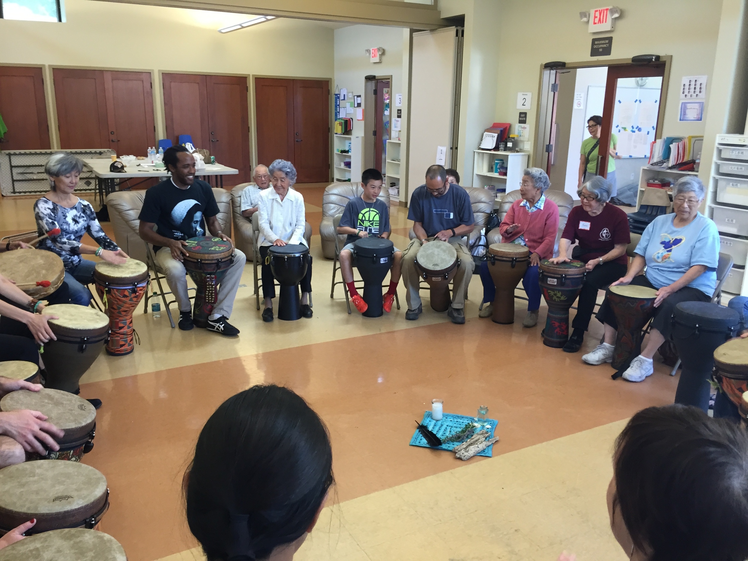 Intergenerational drumming circle led by sekayi edwards, director of CSL's Creative expression program