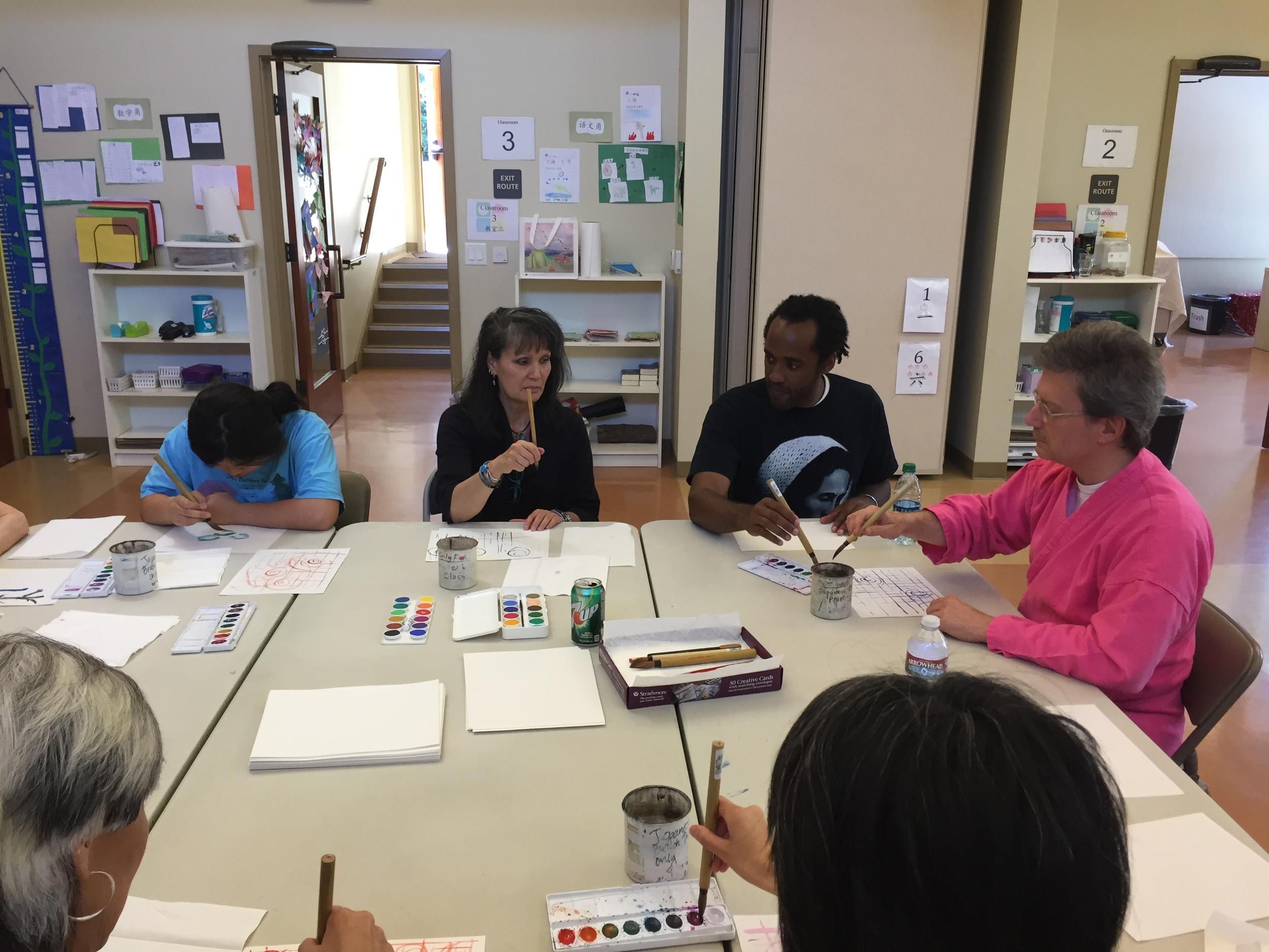 Artist, Patti Iseke, leads a group painting brushwork workshop