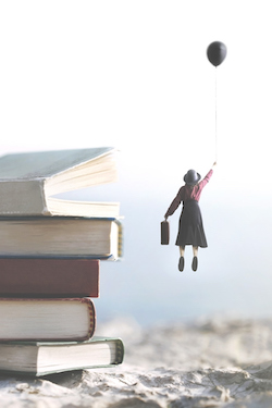 woman-carried-by-a-balloon-flies-above-a-mountain-of-giant-books-1071663286_2579x3869.jpeg