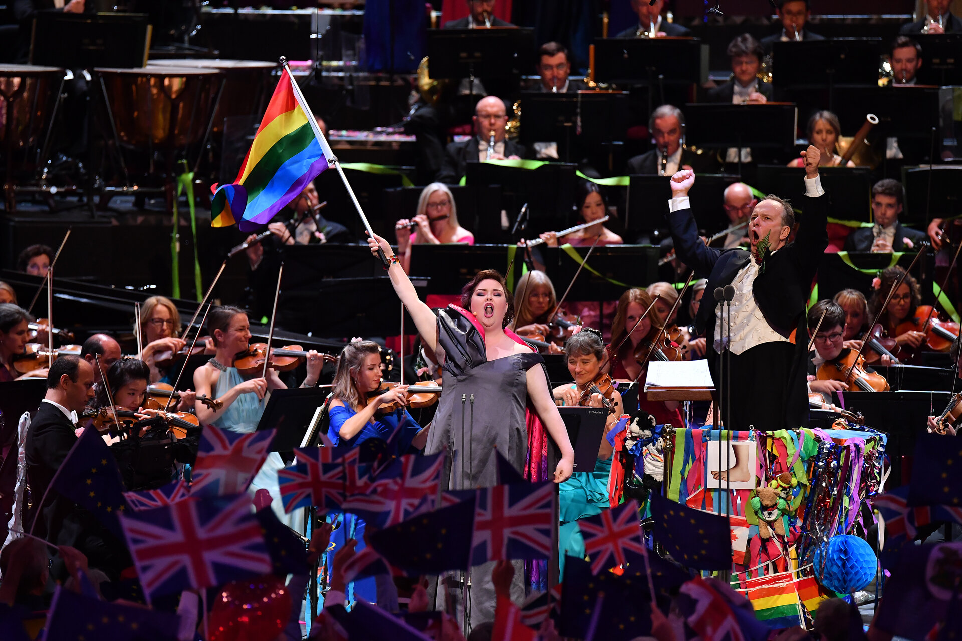 Jamie lifts the Pride Flag aloft at Last Night of the Proms. (Photo by Chris Christodoulou)