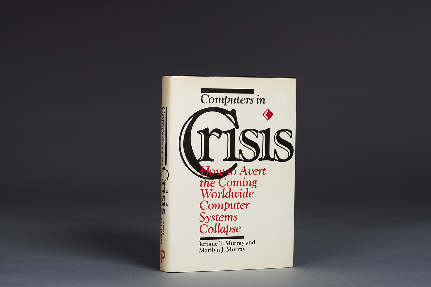 Computers in Crisis  by Jerome T. Murray & Marilyn J. Murray (1984)was the first book published about the computer date problem later known as Y2K.