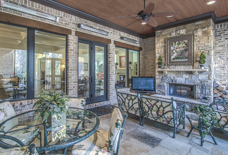 Art on screened in porch - art lover's dream home
