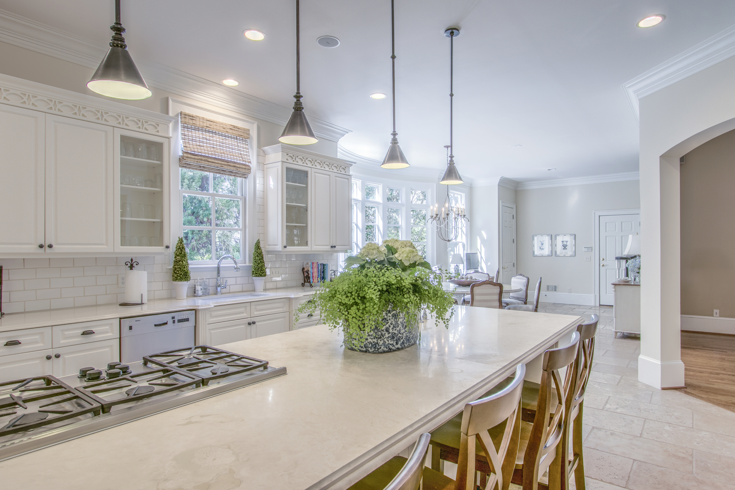 Kitchen island with pendant lights and arches