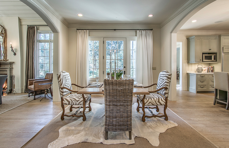 Breakfast room with family room to the left and kitchen to the right.