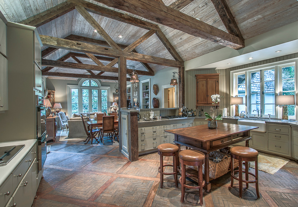 French Kitchen with Brick Floors and Wood beams
